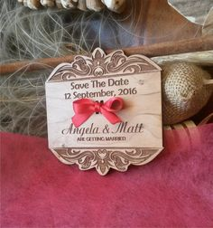 Save the date wooden magnet .    This save the date magnet made from cherry wood looks really great . Very impressive wedding invitation for