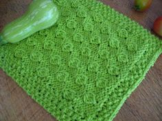I think the hazelnut stitch from Super Stitches Knitting looks a lot like a field of cabbages. The green yarn helps complete the transformation from filbert to brassica. Shown in Lily Sugar'n…
