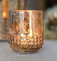 """Array Glass Votive Holder in Rose Gold - 3"""" Tall x 2.5"""" Diameter.  Add candlelight to this pretty glass votive for beautiful ambiance, or fill with flowers to create adorable wedding centerpiece accents for a glam theme!"""