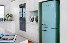 I really want a smeg refrigerator someday!! Love the clean lines and retro look!