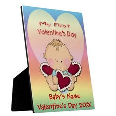 My 1st Valentine's Day (boy) Plaque With Easel features a pastel rainbow gradient background, a cartoon baby boy in front of a yellow and pi...