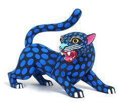 Luis Pablo ~ Oaxaca panther • http://www.oaxacafinecarvings.com/woodcarvings6/luispablojaguar3.htm