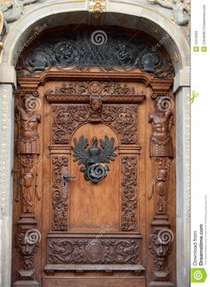 An old wooden door with ornaments and sculptures in old city Gdansk, Poland.