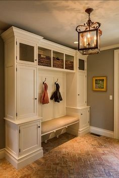 Mud Room with Crown molding, Ashley Bronze 4-light Foyer Hanging Lantern, Havana utility baskets, Standard height, Chandelier