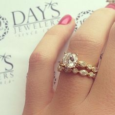 Timeless, vintage, detailed yellow gold diamond engagement ring with matching band from Day's Jewelers