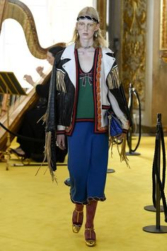 Alessandro Michele's Italianate magpie eye for excess and extravagance roams unfettered across centuries, taking everything from '60s psychedelic print palazzo pantsuits to '70s-accented Renaissance revival gowns to substantial capes, windowpane checked tweed tailoring, and sensible quilted outdoor coats for Gucci's Cruise 2018 collection.