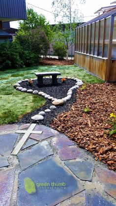 Creativity to the max! Rosary garden made using round washed rocks to create the rosary beads and a concrete cross cut into the flagstone.