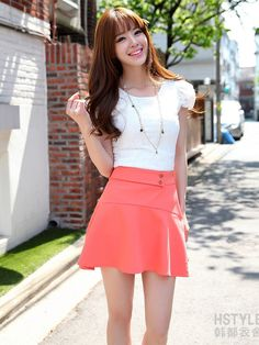 I really like this spring outfit with the white blouse with the pink skirt.