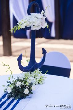 Blue anchor decorated with real carnations and champa flowers, a table accessory Anchor Centerpiece, Nautical Wedding Centerpieces, Nautical Wedding Theme, Nautical Party, Beach Wedding Favors, Wedding Table, Wedding Decorations, Table Decorations, Deco Table