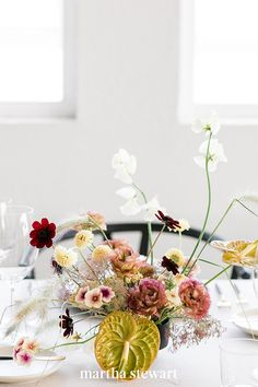 """Subtle black vessels allow the rich tones of your floral centerpieces to stand out. """"Adding warmth through small touches of color or candlelight is ultra-important,"""" says Stafford, noting that this transports you to family holidays or an intimate date night at home. #weddingideas #wedding #marthstewartwedding #weddingplanning #weddingchecklist Wedding Reception Centerpieces, Wedding Reception Decorations, Floral Centerpieces, Floral Arrangements, Wedding Ceremony, Martha Stewart Weddings, Event Decor, Event Design, Wedding Designs"""