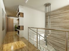 The metal railings of the banister portray a sleek but industrial contemporary look. The textured accent wall subtly matches the warm wood floor of the second story.