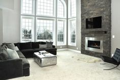 Love the 2 story fireplace/ tv