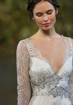 fresh and pretty pink bridal make up - love those long lace sleeves too!