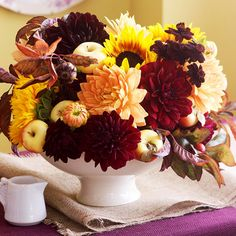 Stunning fall flowers add panache to any centerpiece. More centerpiece ideas: http://www.bhg.com/thanksgiving/indoor-decorating/easy-centerpieces-for-thanksgiving/#page=25