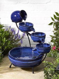 Solar powered ceramic blue Neptune cascading fountain by Smart Solar