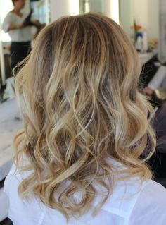 Hair Color & Style: Baby Blonde, Sunkist. Beachy Waved. Medium length.
