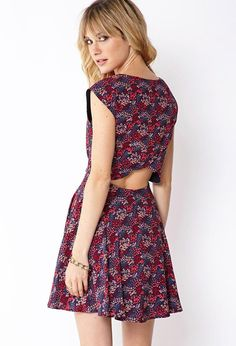 Love 21 - A skater dress featuring a floral print. Round neck. Scalloped tulip back. Invisible ba...