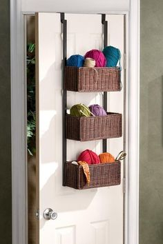 Over the door baskets for hats and gloves in our coat closet. Could I make this with my own baskets and ribbon/fabric?