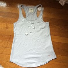 Hollister Tank Light gray Hollister tank with sequin and flower detail around the neck. Beautiful tank, great for layering under cardigans Hollister Tops Tank Tops