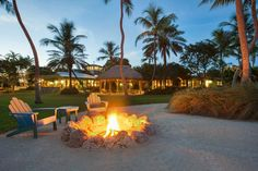 Loose stacked fire pit on a tropical resort. See 14 more gorgeous fire pits here >> http://blog.diynetwork.com/maderemade/2015/07/22/15-fire-pits-to-inspire-your-sizzling-summer/?soc=pinterest