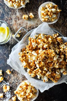 Salted Caramel Popcorn - great party food! Easy and fast to make, and keeps well for a 2 to 3 days. Use muffin tin casings to make individual servings!