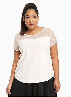 """<div><div>Don't call it a throwback! This blush pink crepe top feels totally new age with a lightweight and airy fit. The mesh inset, detailed with polka dots, is retro with a hint of modern sex appeal (it's semi-sheer). The button back is totally living in the now.</div></div><div><br></div><div><b>Model is 5'10"""", size 1</b></div><div><ul><li style=""""LIST-STYLE-POSITION: outside !important; LIST-STYLE-TYPE: disc !important"""">Size 1 measures 28 3/4"""" from shoulder</li><li style=""""LIS..."""