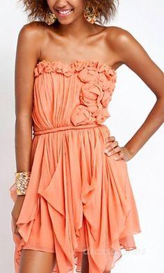 Warm peach junior dress. Ruched, sleeveless top with fabric flowers. Draped sheer handkerchief skirt. Fresh and cute!