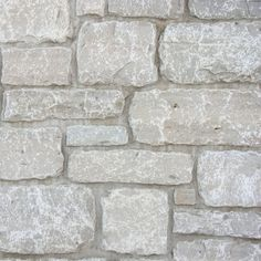 Eden Machine Cut Veneer is a gray to buff, splitfaced building stone. Stone Fireplace Pictures, Grey Stone Fireplace, Stone Fireplace Surround, Modern Fireplace, Fireplace Design, Stone Exterior Houses, Wall Exterior, Stone Houses, Landscaping With Fountains