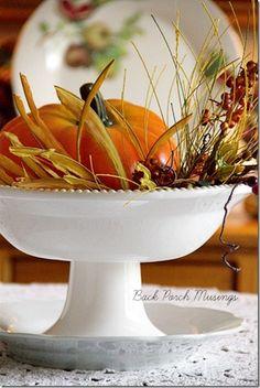 Love pumpkins in white bowls:
