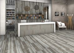 Tired of a traditional wood look? Enter Burlwood and a new modern romance. This polished Gray look adds shine and sheen to the beautiful line work of natural wood.  #tile #porcelain #ceramic #glass #interiordesign #homedecor #architecture #tileaddiction #mosaic #walltile #floortile #tilestyle #designlovers #housetour #kitchentile #homerenovation #homedecor #design #tiles #interior #tiling #flooring #diy #largeformattiles #bathroom #hgtv #planktiles #tilewalls #surfaceartinc #tilevisualizer
