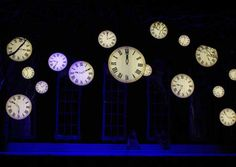 """In the Washington Ballet's spectacular production of Cinderella, the clocks say it all, direct dye printed by Rose Brand on lightbox material. The forest scene consists of cut drops in Rose Brand's 120"""" 12 oz canvas."""