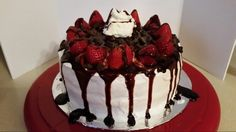 Strawberry cake with vanilla pudding frosting and drizzled chocolate