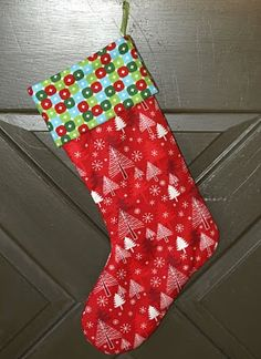 Stocking pattern: Turned out freaking adorable. Pinner said: I added a mini pom pom garland, buttons, & puff paint for Luke to play with (big hits). Make sure you keep your seam allowances narrow or else the stocking ends up weirdly skinny (had to redo once). Pattern tutorial is really easy to follow.