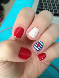 While this red, white, and blue manicure would look perfect on Fourth of July, its classic stripes and adorable heart make it a fun nail art pick all year round.
