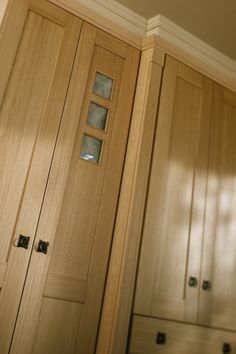 Shaker Solid Oak fitted wardrobe doors are manufactured from real oak. The frame of the doors are machined from solid oak and the inner door panels are a high quality genuine oak veneer. All drawer fronts are solid oak also. Take a look at the decorative feature doors, with three small beautifully crafted windows. Country and art deco combine to make any size of built-in bedroom wonderfully expressive. Fitted Wardrobe Doors, Fitted Wardrobes, Walk In Wardrobe, Veneer Door, Built In Cupboards, Oak Panels, Door Storage, Cottage Ideas, Drawer Fronts