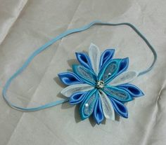 Check out this item on Etsy https://www.etsy.com/listing/454826680/frozen-inspired-baby-headband-ready-to