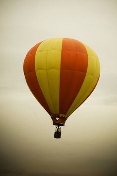 Hot Air Balloon: Drifting among clouds - Carried upon the wind's breath - High above ground