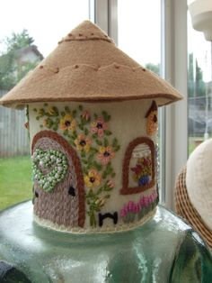 Pin Cushion made of felt and pretty embroidered embellishments...great inspiration!!