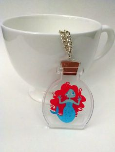 $20 Bottled Mermaid clear acrylic charm necklace by theGorgonist