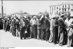 """Jews of Thessaloniki, Greece line up for registration and assignment to hard labor, July 1942. Under a burning sun, thousands of men were kept doing calisthenics and other """"exercises"""" by their German overlords. Very few of the people in this photo survived the war; by 1944, the entire Jewish population had been deported to Auschwitz and gassed on arrival."""