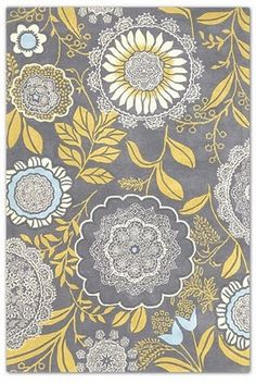 This Amy Butler rug has me captivated, but with it's cost nearing 4 digits I will have to admire from my pinboard...