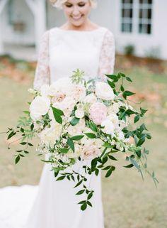 White and Blush Overgrown Bouquet | Photography: Amanda Watson Photography | Gown + Accessories: J.J. Kelly Bridal Salon | Florist: Juniper Designs | Makeup: Chelsey Ann Artistry | Venue: Spain Ranch | #weddings #bridesofok #bouquets