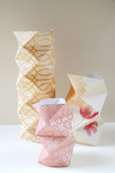 DIY: origami paper vases made from scrapbook paper. For more DIY inspiration go to www.canberracreatives.com.au