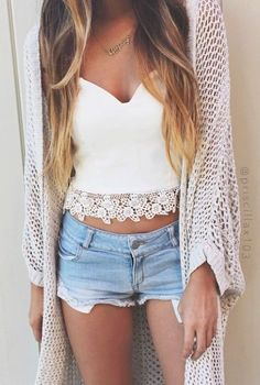 summer fashion: open knit cardigan, light wash shorts and a white crop top with lace detailing