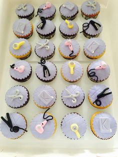 Salon Themed Cupcakes. White and chocolate cupcakes with fondant and gumpaste hair dryers, straightening irons, brushes, scissors and Kevin Murphy shampoo bottles.