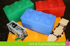 Recycled cardboard milk carton & plastic milk jug lids, painted to look like legos, to use as a gift box! My friend Ursula made up this awesome idea.
