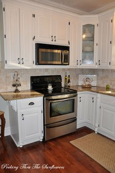 The kitchen cabinets were found on Craig's List. They are custom made solid oak cabinets that were originally stained. We reworked them to fit our kitchen layout and added moldings, bead board, hardware, and seeded glass.