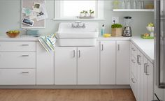 kitchen design + art direction: barbara schmidt of studiobstyle, studiobstyle.com sink + faucet: country kitchen sink, heritage 2-handle wall mount, by American Standard (americanstandard-us.com)  countertop: brite white #459 gloss finish, lower cabinets: brite white #459 matte finish, custom made by Formica (formica.com)