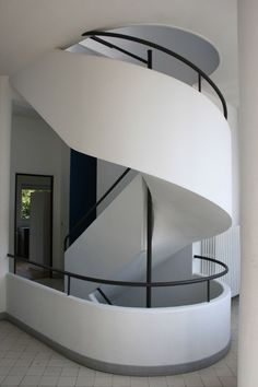 Sculptural staircase inside Villa Savoye by Le Corbusier