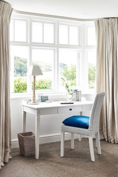 Bedroom work space boasts a bay window dressed in natural linen French pleat drapery panels filled with a white french desk and a white wicker chair adorned with a jewel blue velvet chair. Bay Window, House Interior, House, Home, Interior, White French Desk, White Room Decor, Bedroom Layouts, White Wicker Chair